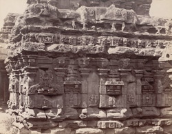 Close view of wall, showing moulding and sculptural details, of one of the shrines of the Navalinga Temple complex, Kukkunur